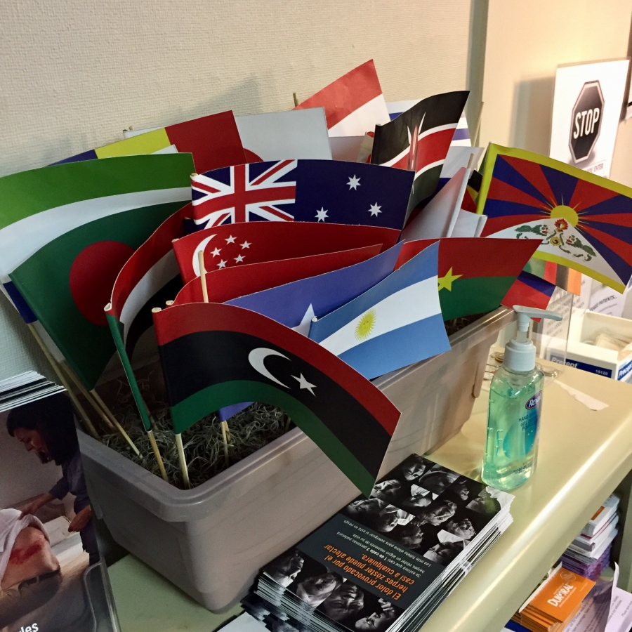 Flags represent some of the home countries of the patients at the clinic.