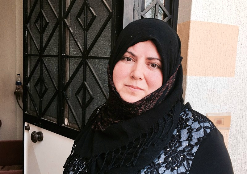 A 37-year-old refugee from Idlib, she tried to send her brother's body back to Damascus.