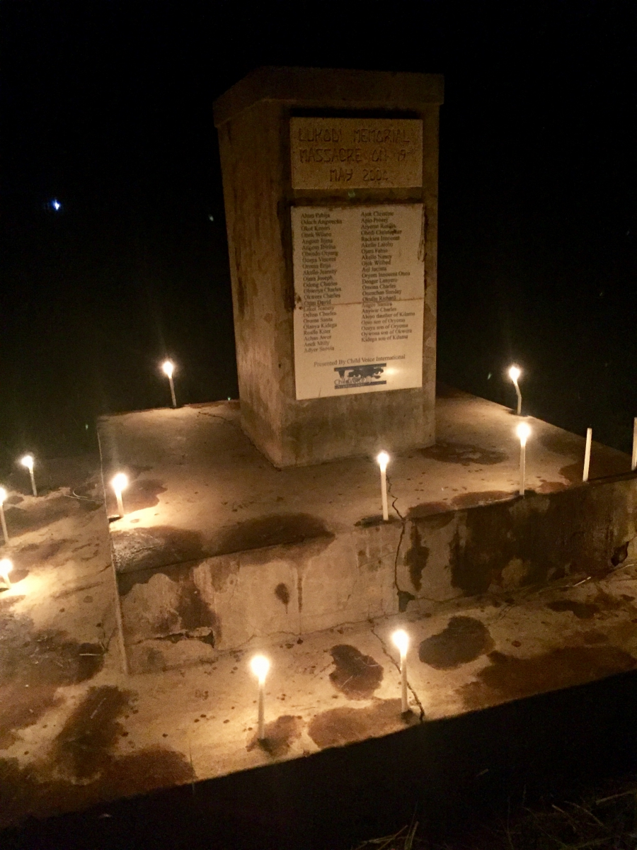 A memorial with candles on it to honor those killed by the Lord's Resistance Army in Lukodi, Uganda.
