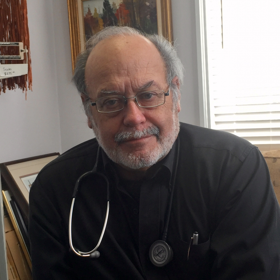 Dr. Paul Caulford runs a clinic in for refugees without health insurance.