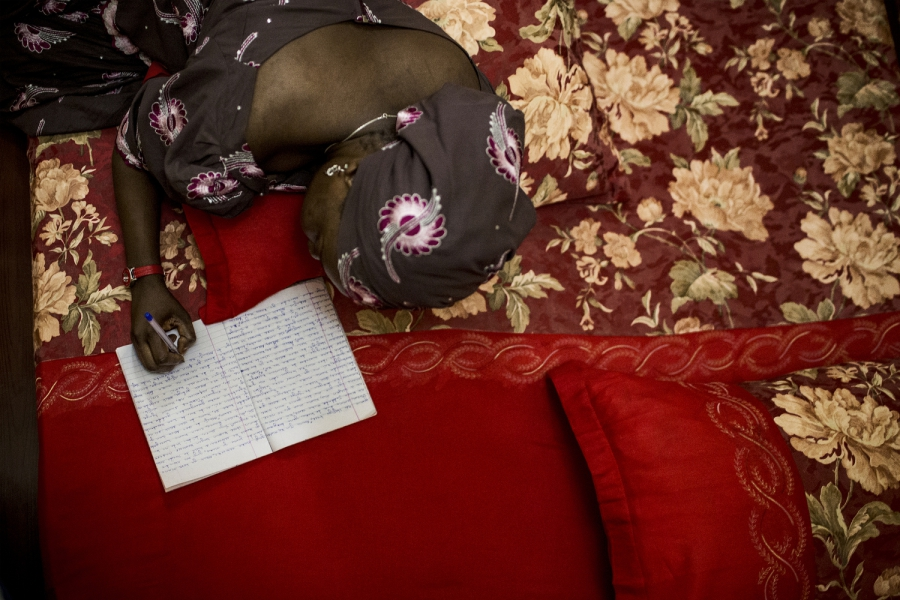 Hadiza Sani Garba writes her novels in bed or in her sitting room, by hand, in small composition books.