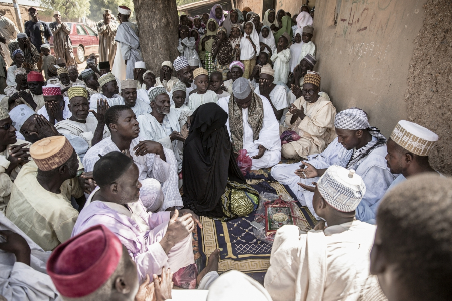 The wedding fatiah of a village girl. A contract is announced and the men of the village say prayers and recite blessings. Women rarely interact with men who are not their relatives