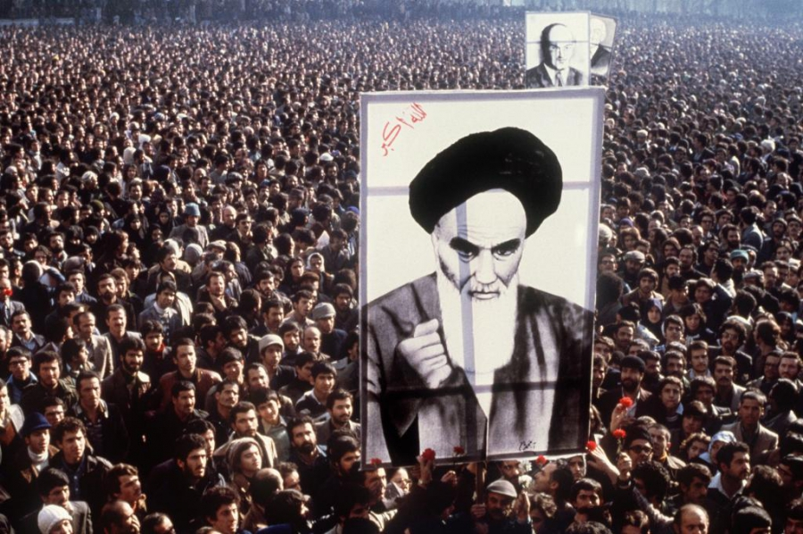In a file picture taken in January 1979, Iranian protesters hold up a poster of Ayatollah Ruhollah Khomeini during a demonstration in Tehran against the Shah. Weeks later, the US-backed leader was toppled. Months later, the Islamic Revolution in Iran was