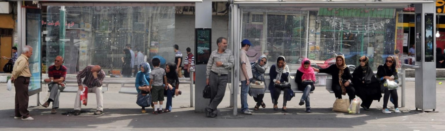 Iranians sit at a bus station in Tehran on July 16, 2015.