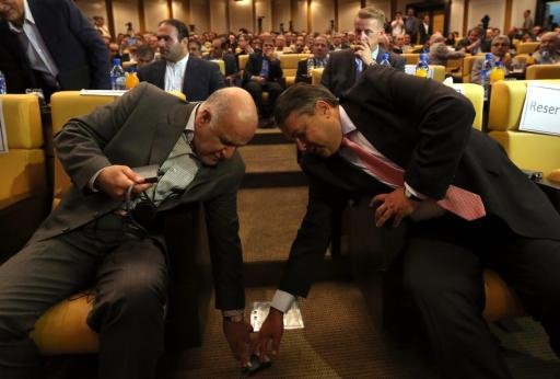 German Economy and Energy Minister Sigmar Gabriel (R) and Iranian Oil Minister Bijan Namdar Zanganeh (L) fall all over each other at Iran's Chamber of Commerce in Tehran on July 20, 2015, days after the nuclear accord was struck.