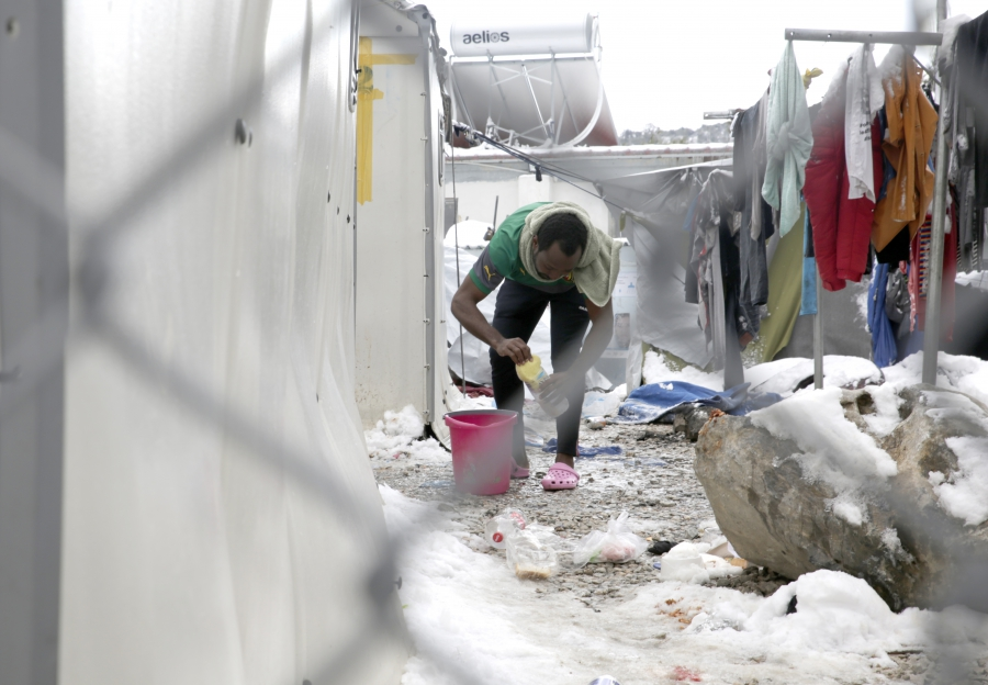 An English-speaking Cameroonian migrant washes himself at the Moria Refugee Camp on the Greek island of Lesbos.