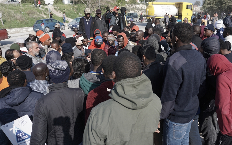 A group of African migrants, including English-speaking Cameroonians, protest against the deportations of asylum-seekers on the Greek island of Lesbos.