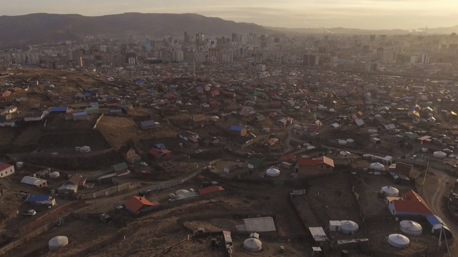 """A growing patchwork of dirt roads, fences and circular tent homes called """"gers,"""" or yurts, is spreading on the outskirts of Ulaanbaatar. Recently more than 200,000 households of former nomads have settled here."""