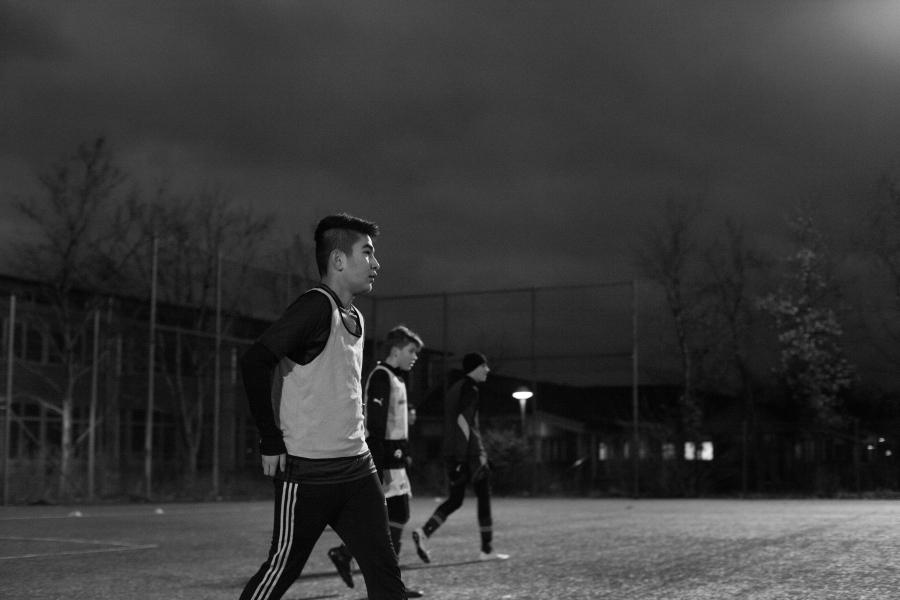 Hadi and Mahdi playing soccer.