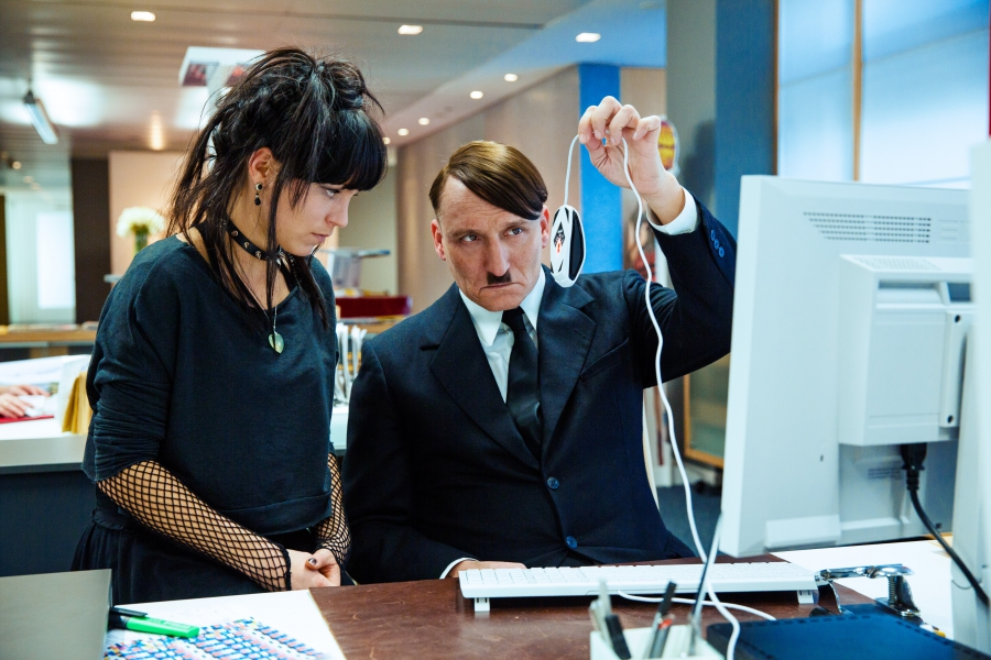 Hitler trying to learn how to use a computer and mouse