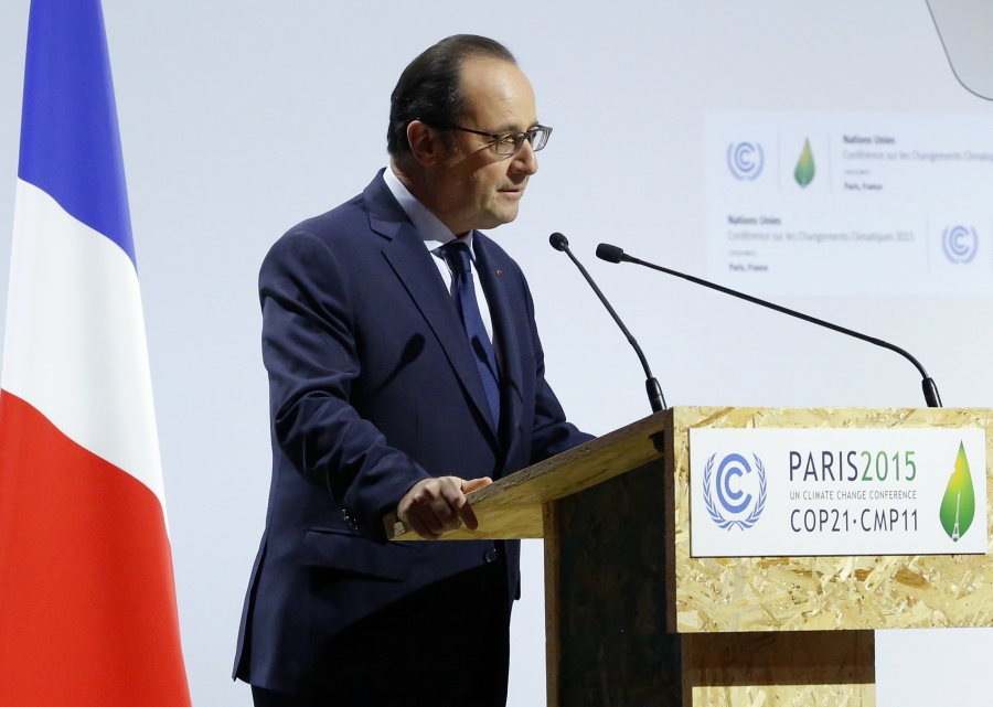 "French President Francois Hollande speaks on the opening day of the 2015 World Climate Change Conference in Paris, less than three weeks after a string of attacks in the city killed at least 130 people. ""The challenge of an international meeting has never"
