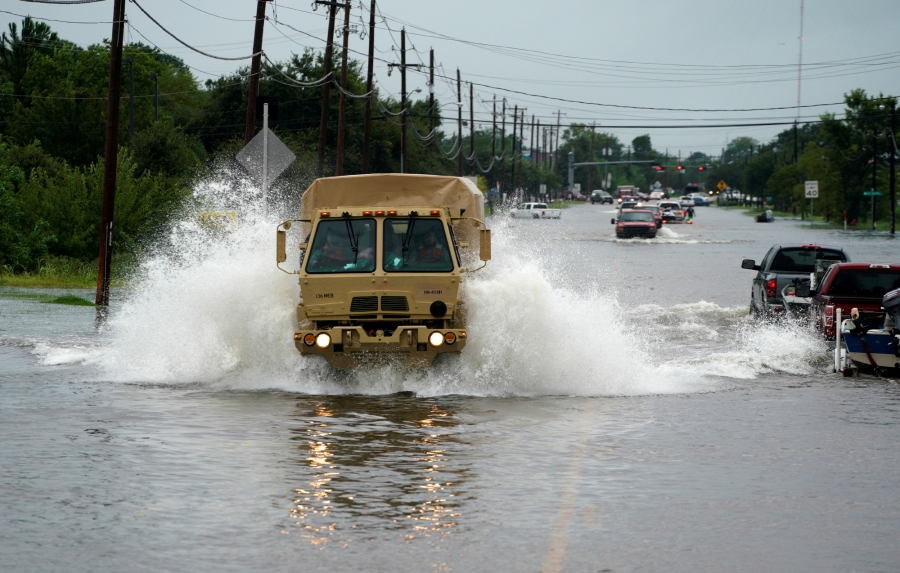 People are evacuated by a high water truck from the Hurricane Harvey floodwaters in Dickinson, Texas.