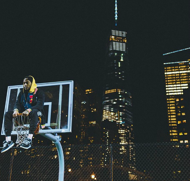 A photo of one of Humza's friends on a basketball hoop, with 1 World Trade Center in the background.