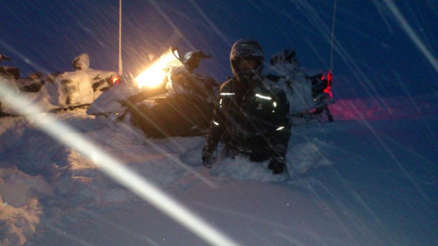 Snowmobile rescue crews work to reach stranded skiers on Vatnajökull glacier, Iceland.