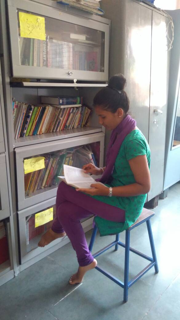 A young girl reads at a shelter for women who have survived sex trafficking.