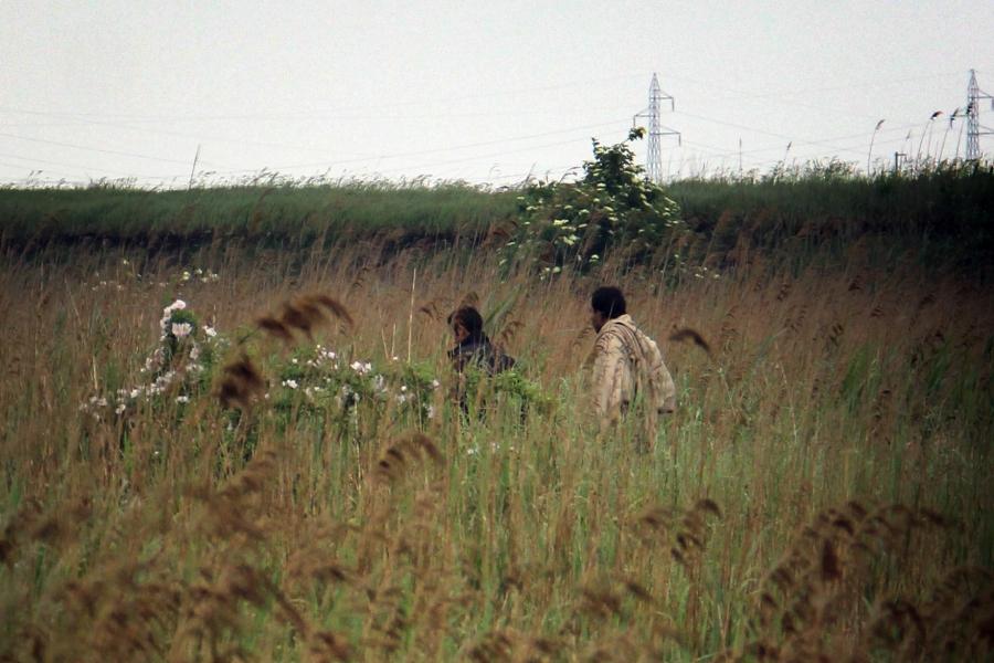 Migrants walk through a field near the Serbian-Hungarian border.