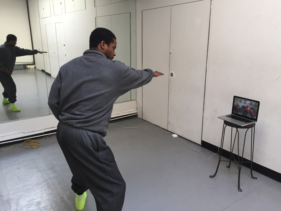 Sean Scantlebury in New York gives a dance lesson to Aadel Qies in Baghdad