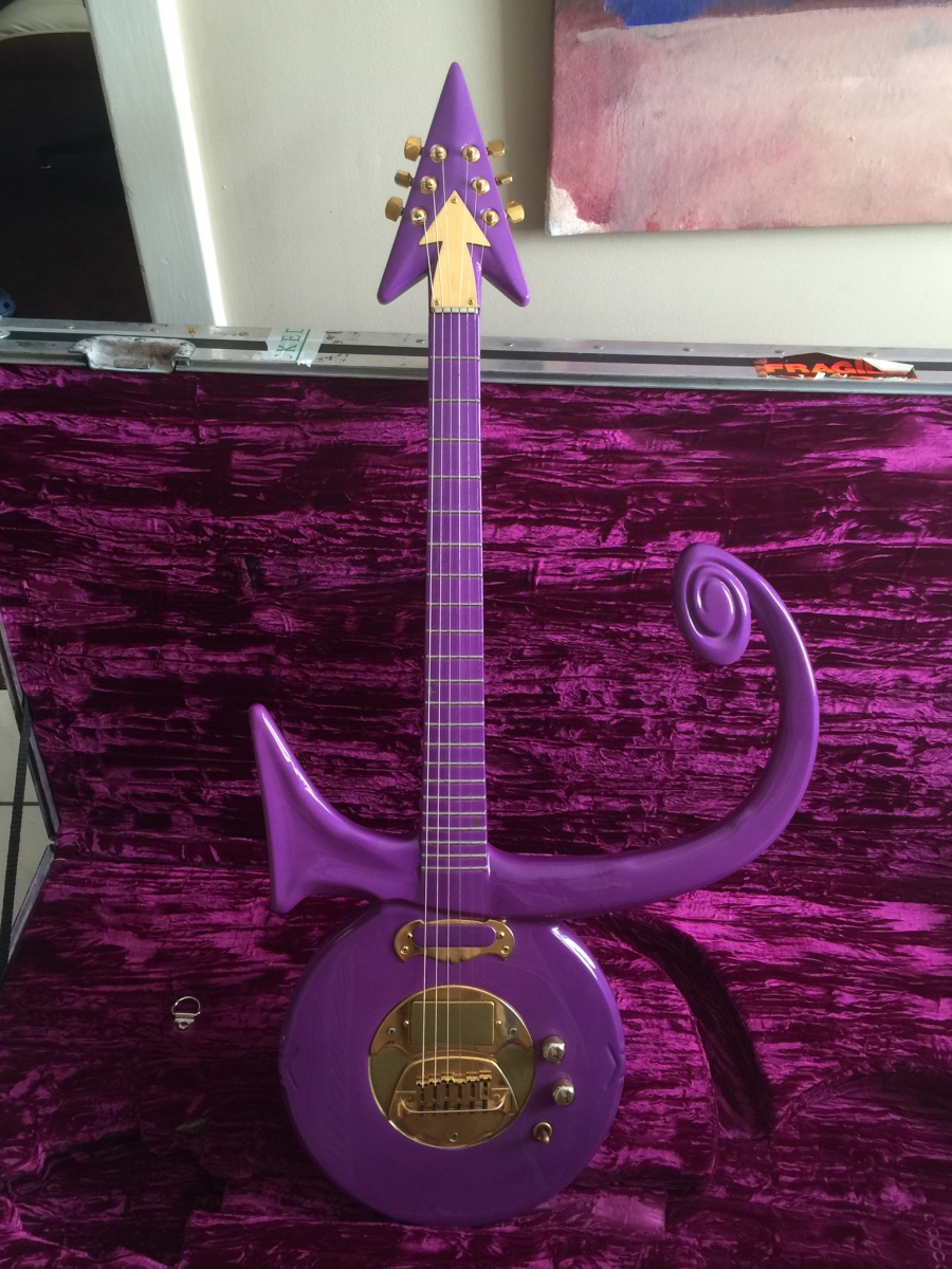 Tavis smiley ill never know why prince chose me as one of his a purple guitar in the shape of the love symbol buycottarizona