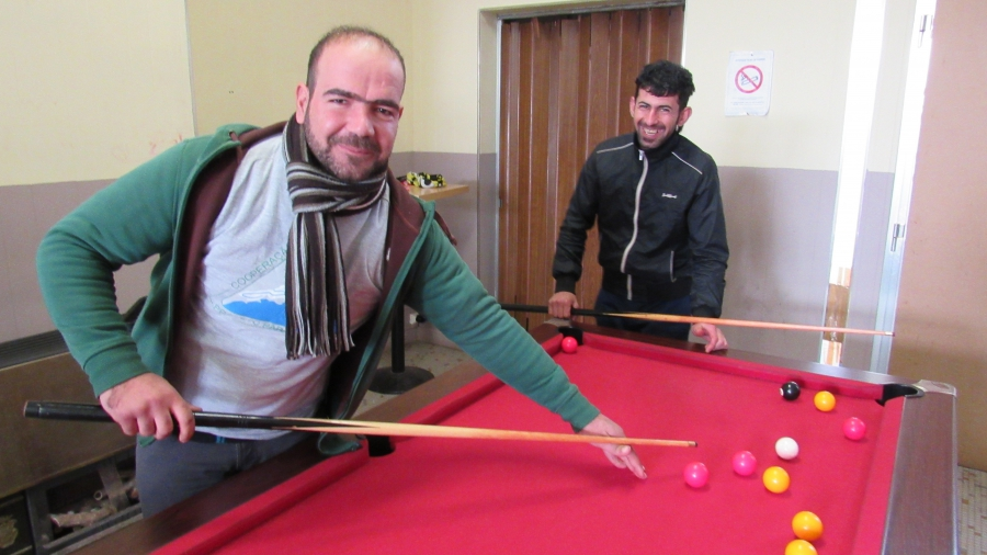 Two Kurdish migrants from a nearby refugee camp enjoy the warm, the tea and the fun of Café Elleboode.