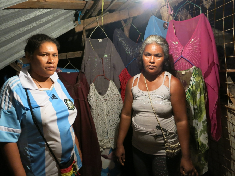 Graciela Sosa Martinez, right, and Arele Palma Sandoval own tourist stands that were wiped out by tropical storm Manuel. Located right on the ocean, they worry it will happen again.