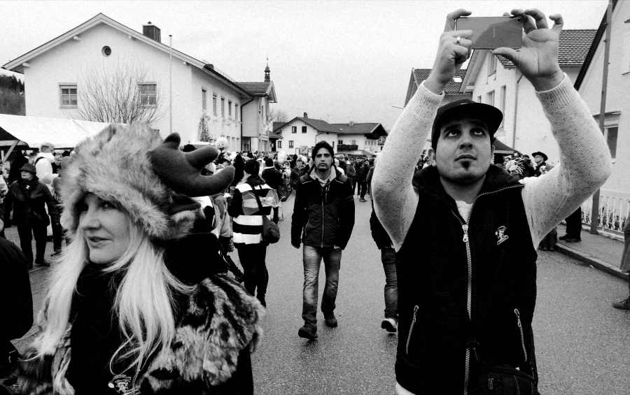 Ali Daas takes photos during Carnival in Altenmarkt, Bavaria.