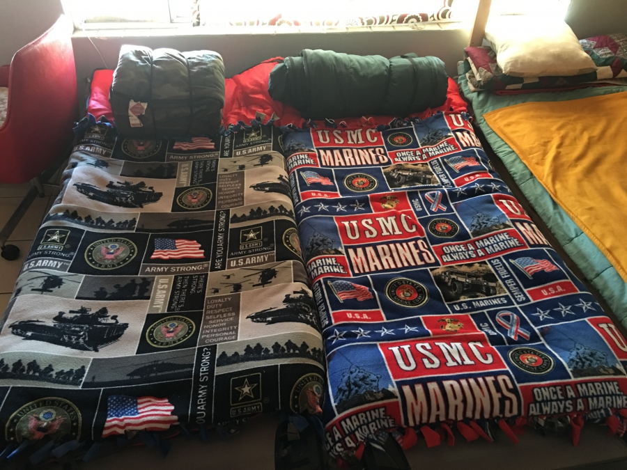 Beds at The Bunker have military motif blankets