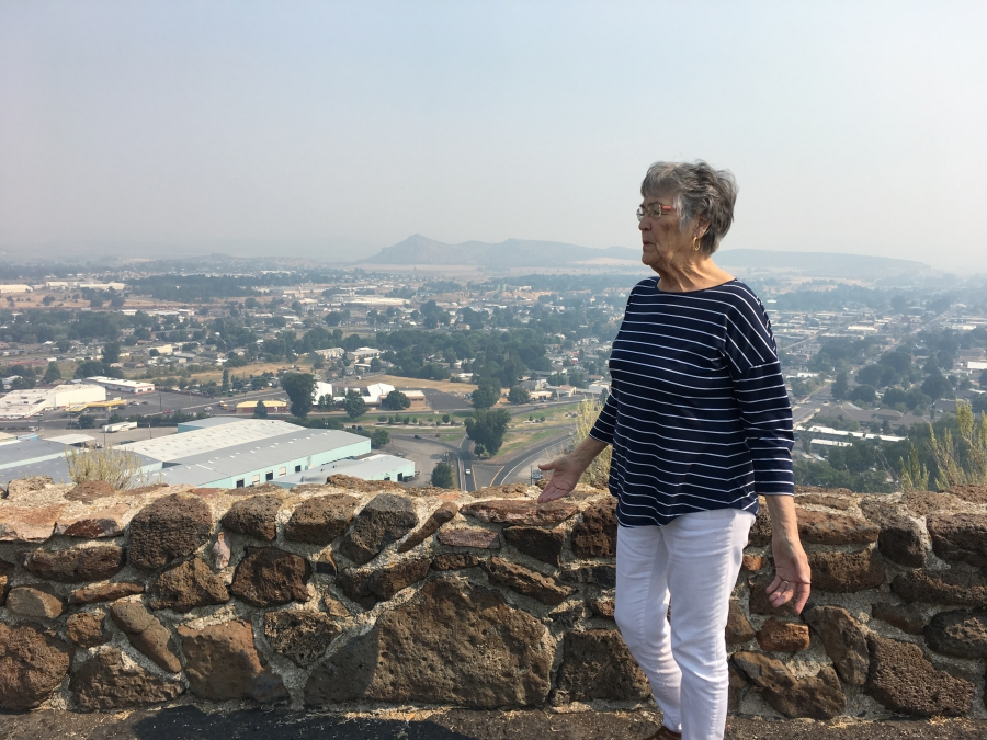 Mayor Betty Roppe stands above the valley at the heart of Prineville, Oregon.