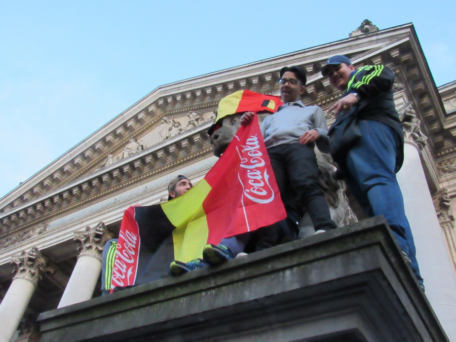 Youth display a modified Belgian flag during a rally at the old Belgian Stock Exchange.