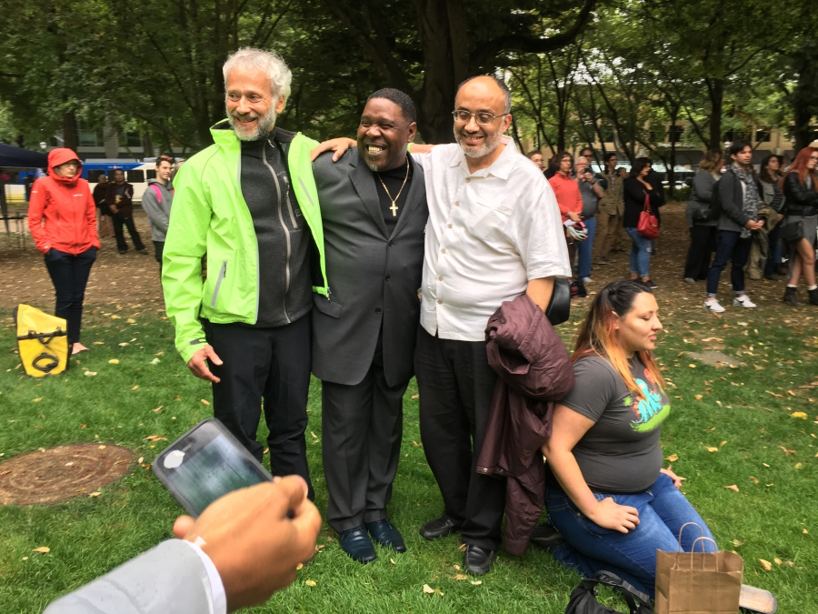 Wajdi Said, right, stands with other Portland activists in a city park. Said is president and co-founder of the Muslim Educational Trust.