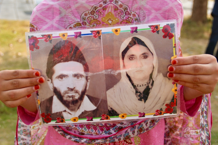 Nabila ur Rehman holds a photo of her grandfather and her grandmother