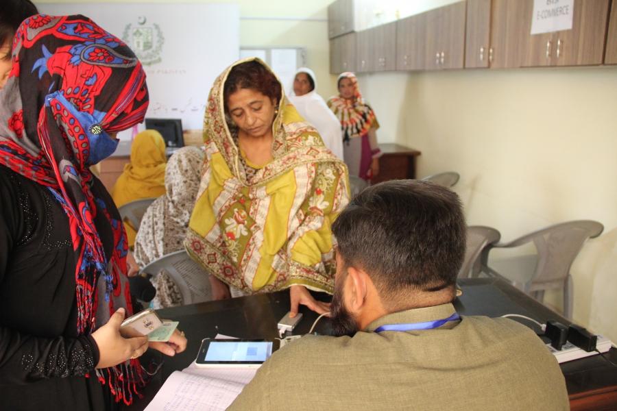 Akhtar Shaheen provides her thumbprint