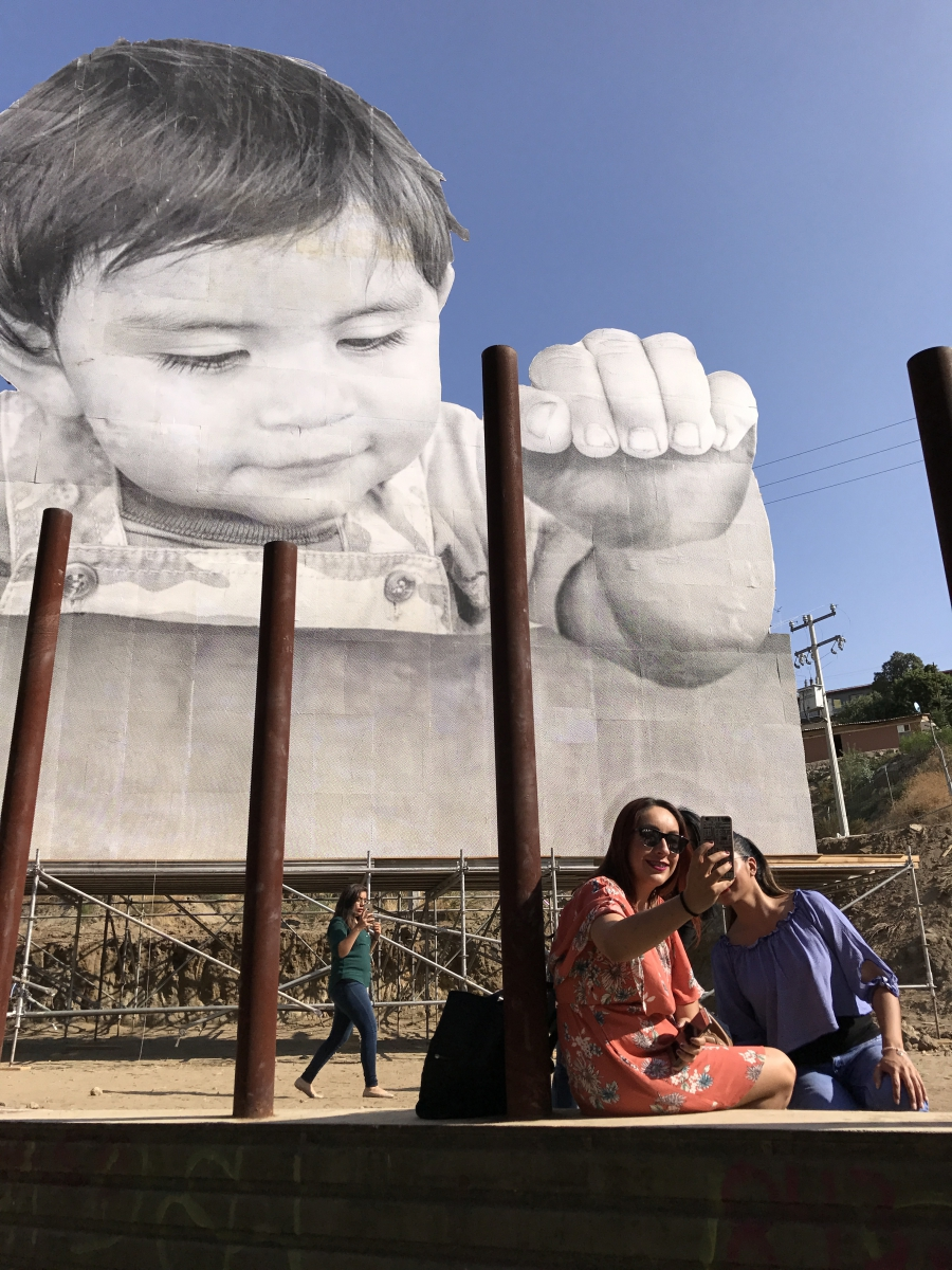mexicans and americans bond over a giant baby and a border wall. Black Bedroom Furniture Sets. Home Design Ideas
