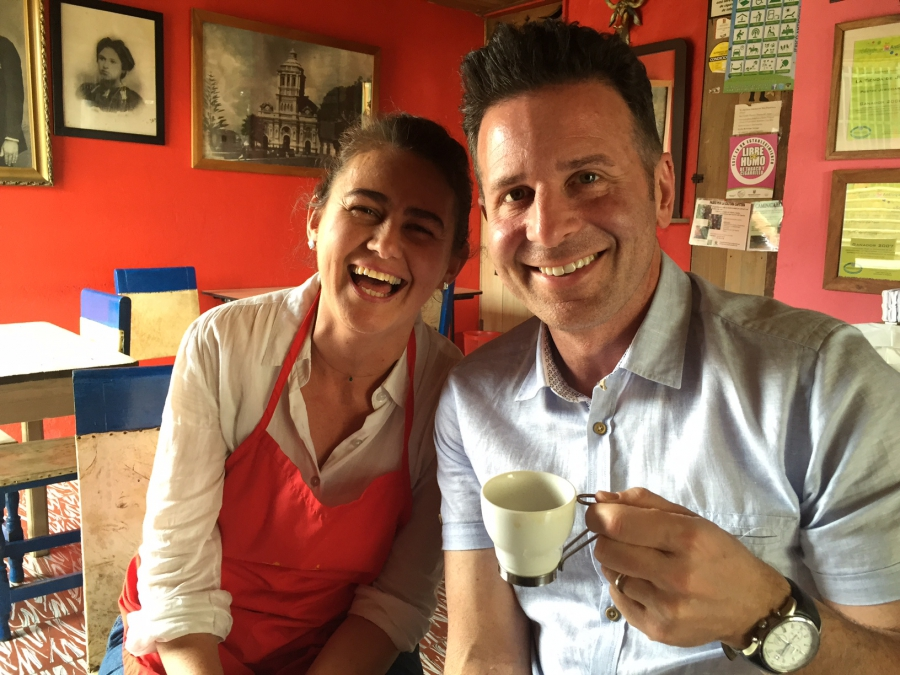 Steve Dolinsky (right) with Nancy Garces, whose family is one of four still making the famous Postre Jericoano