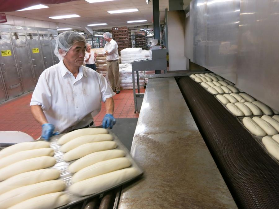 Refugee workers bake bread at the Koffee Kup Bakery in Burlington, VT.  (PRI/Jason Margolis)