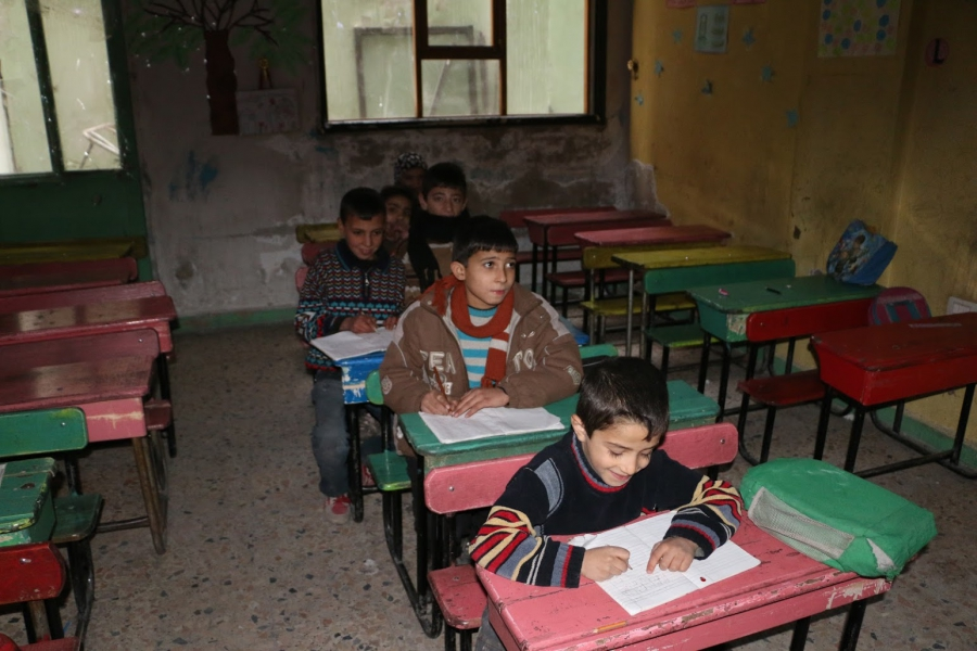 Children taking classes with Herras in Ghouta.