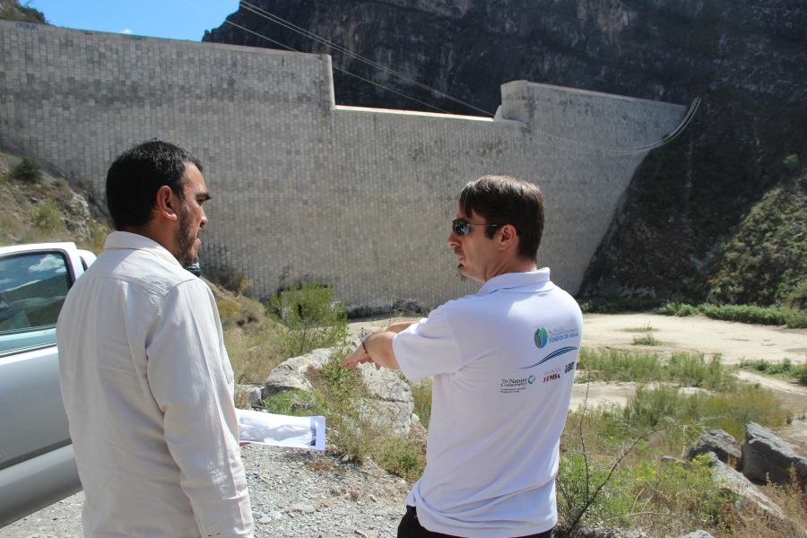 The Nature Conservancy's Colin Herron, right, at the Rompepicos Dam. Water rose to near the top of the dam during Hurricane Alex.
