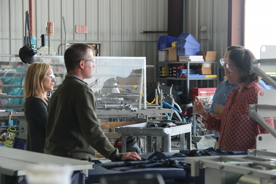 International trade specialist Heather Ranck, right, speaks with Chad Kost and Tammy Einright with Spectrum Aeromed, devising a plan to target export growth.