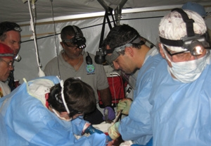 Dr. Ara Feinstein (right) performing trauma surgery on a gunshot wound victim.