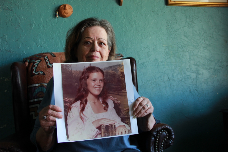 a woman holds up a picture