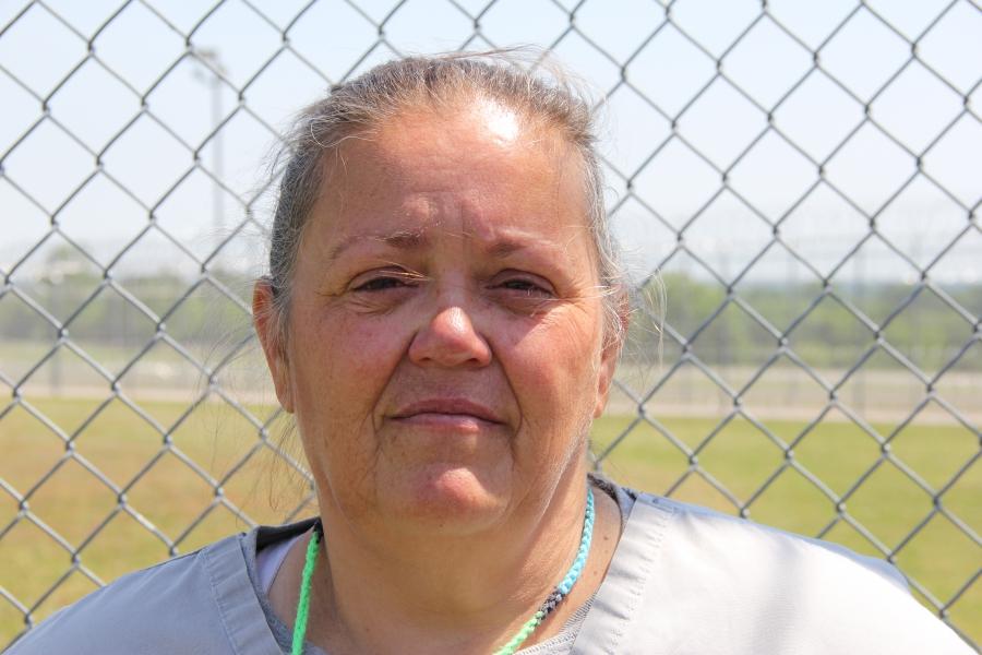 A woman at a prison