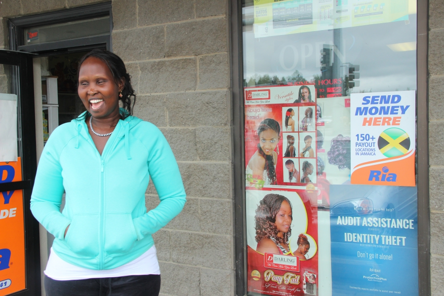 "Nyakor Kueth, owner of the ""African Market,"" has become a local banker for many African immigrants looking for small loans."