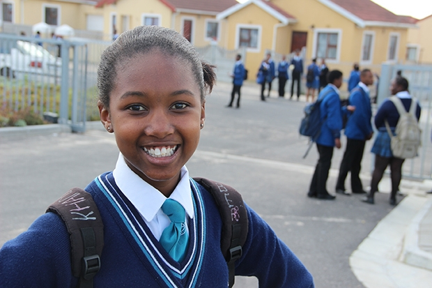 Ninth-grader Khanyisile write notes of positive reinforcement on her backpack. (Photo: Anders Kelto)