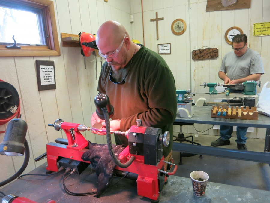 Steelworkers at a woodshop class in Burns Harbor, Indiana. Employees can take classes for personal enrichment as well as to learn new job skills.