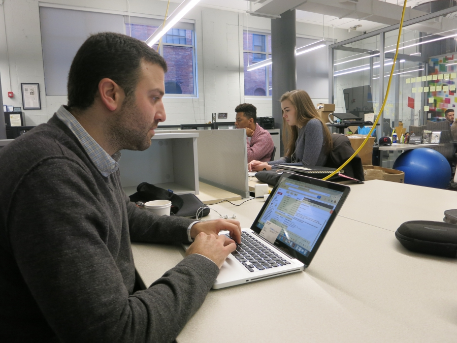 Daniel Shani, left, works out of 43North, a business incubator near downtown Buffalo that houses about 50-60 people.
