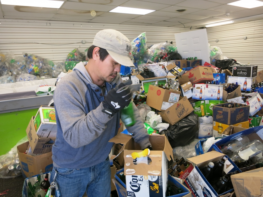 Buffalo resident and Burmese immigrant Zah Win earns his living collecting cans and bottles for recycling.
