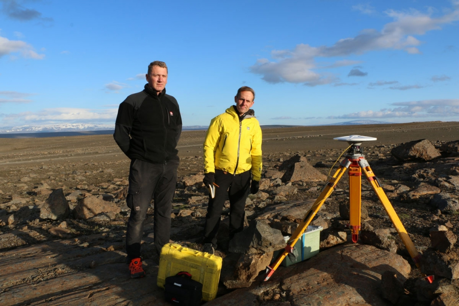 Sveinbjörn Steinþôrsson (L) and Freysteinn Sigmundsson from the University of Iceland stand beside one of their GPS stations that measures the latitude, longitude, and vertical position of the ground.