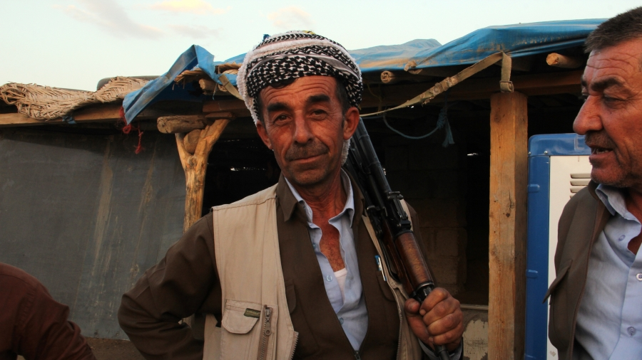 A Kurdish weapons dealer in the Erbil gun bazaar. He's being hawking arms for more than 20 years.