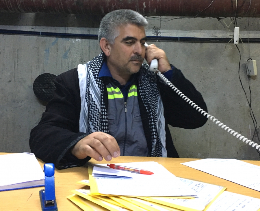 Aquil Muslim at his desk deep inside the Mosul Dam. He says the dam needs constant maintenance but the warnings are overblown.