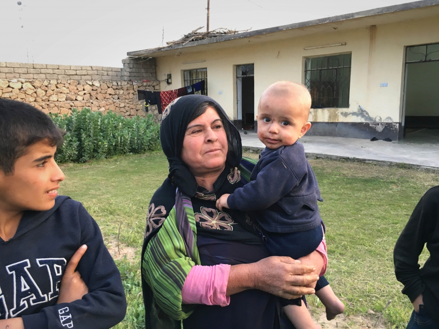 Amina Mohammed outside her home in Wana downstream of the Mosul Dam, which engineers warn is in danger of bursting.