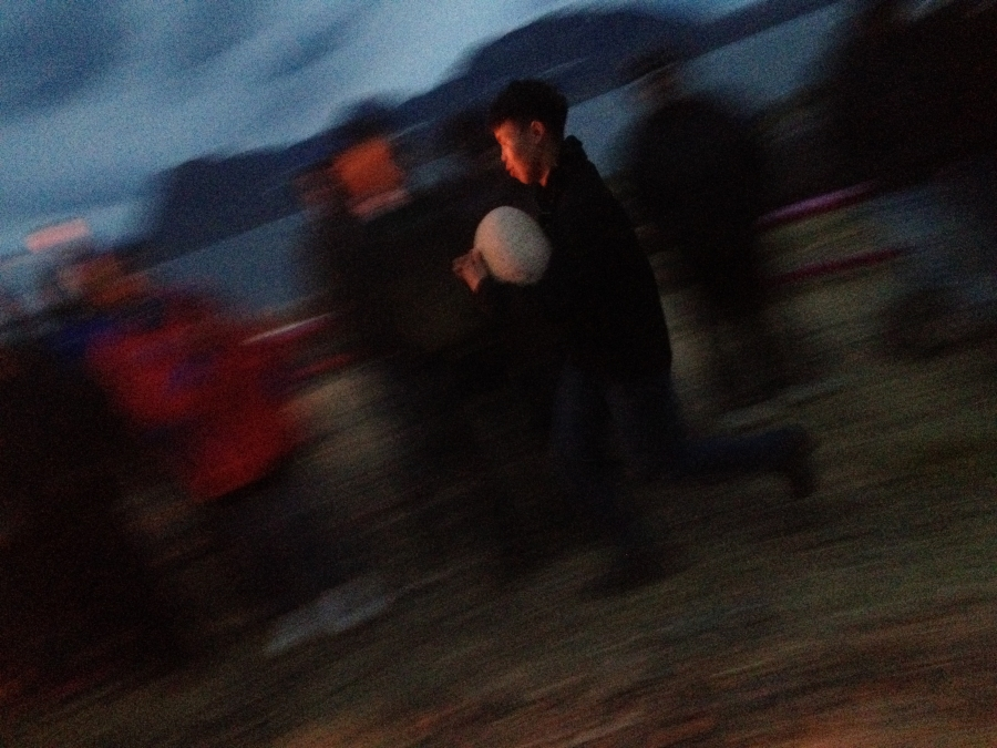 A local boy takes part in the games after dark on the final night of the gathering and celebration.